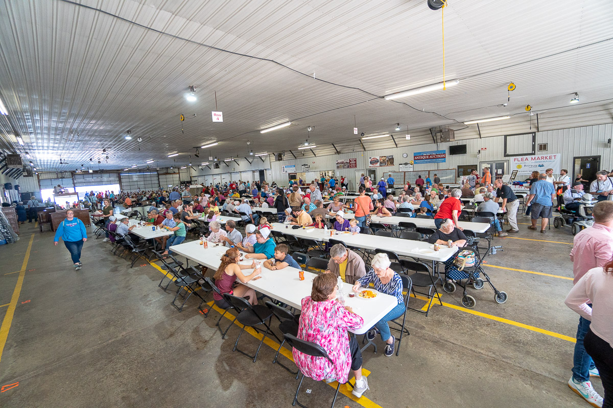 Contributors enjoying a haystack supper at the Shipshewana Auction Barn for The Farm Place fundraiser.