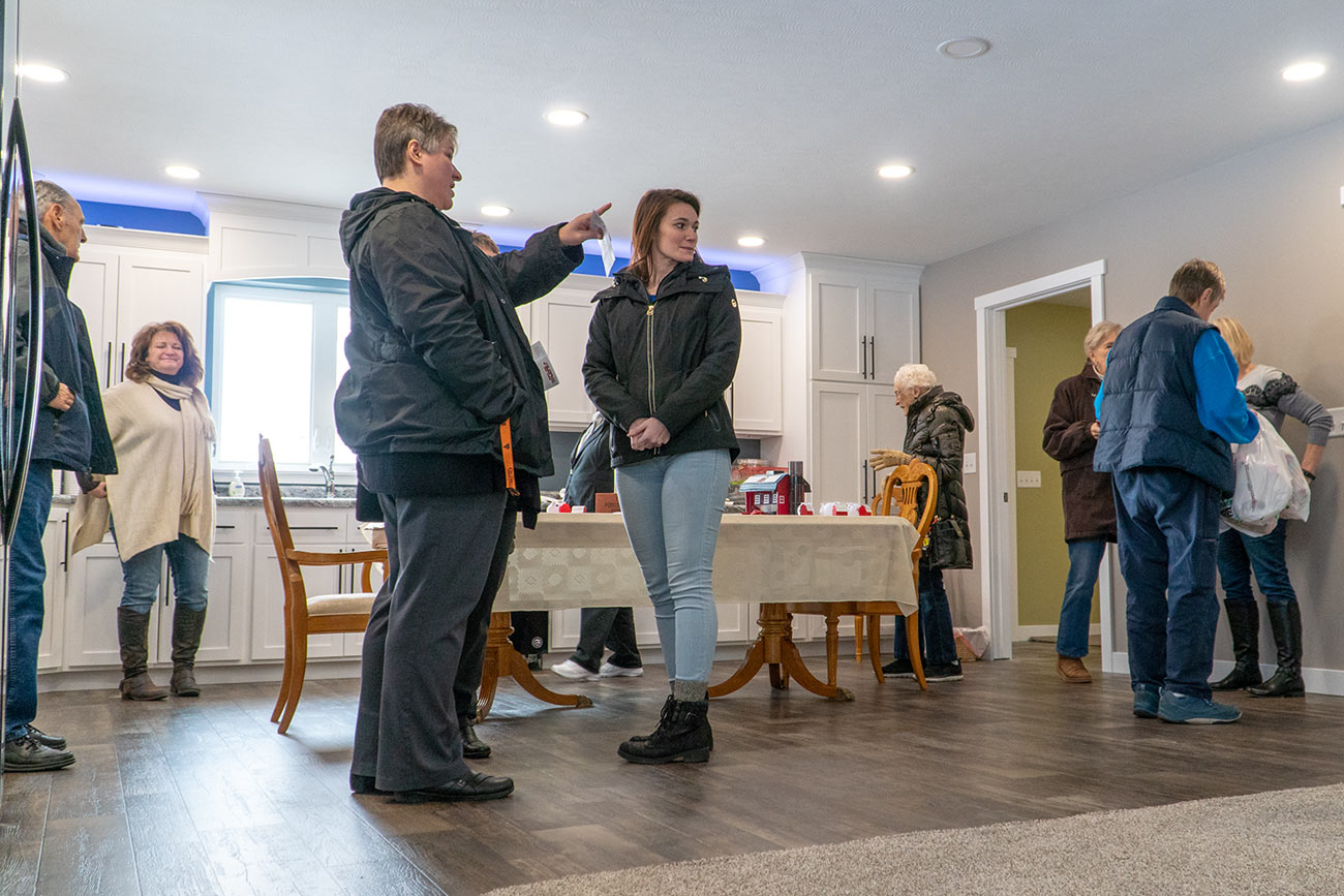 Visitors gather at The Farm Place's first open house.