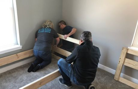 Volunteers assist in building beds donated to The Farm Place by Sleep in Heavenly Peace