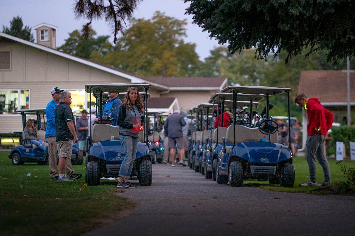 Golf carts and tournament participants line up for The Farm Place fundraiser golf tournament.