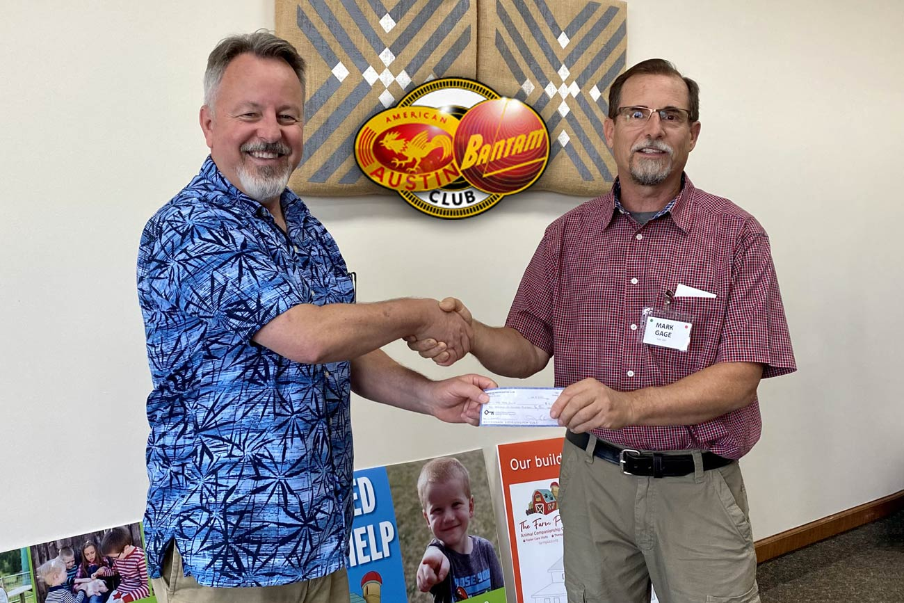 Board Member Keith James accepts a $2,600 check for The Farm Place from AABC President Mark Gage